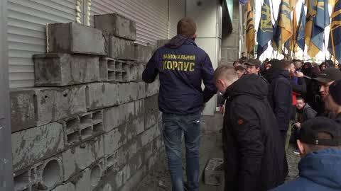 Ukrainian activists build a wall which block entrance to the Sberbank of Russia in Kiev