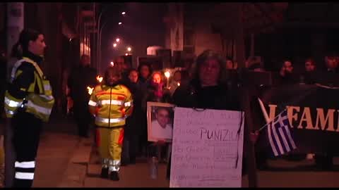 Torchlight procession for earthquake victims in L'Aquila