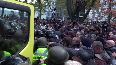 Activists clash with riot policemen during a protest in Kiev