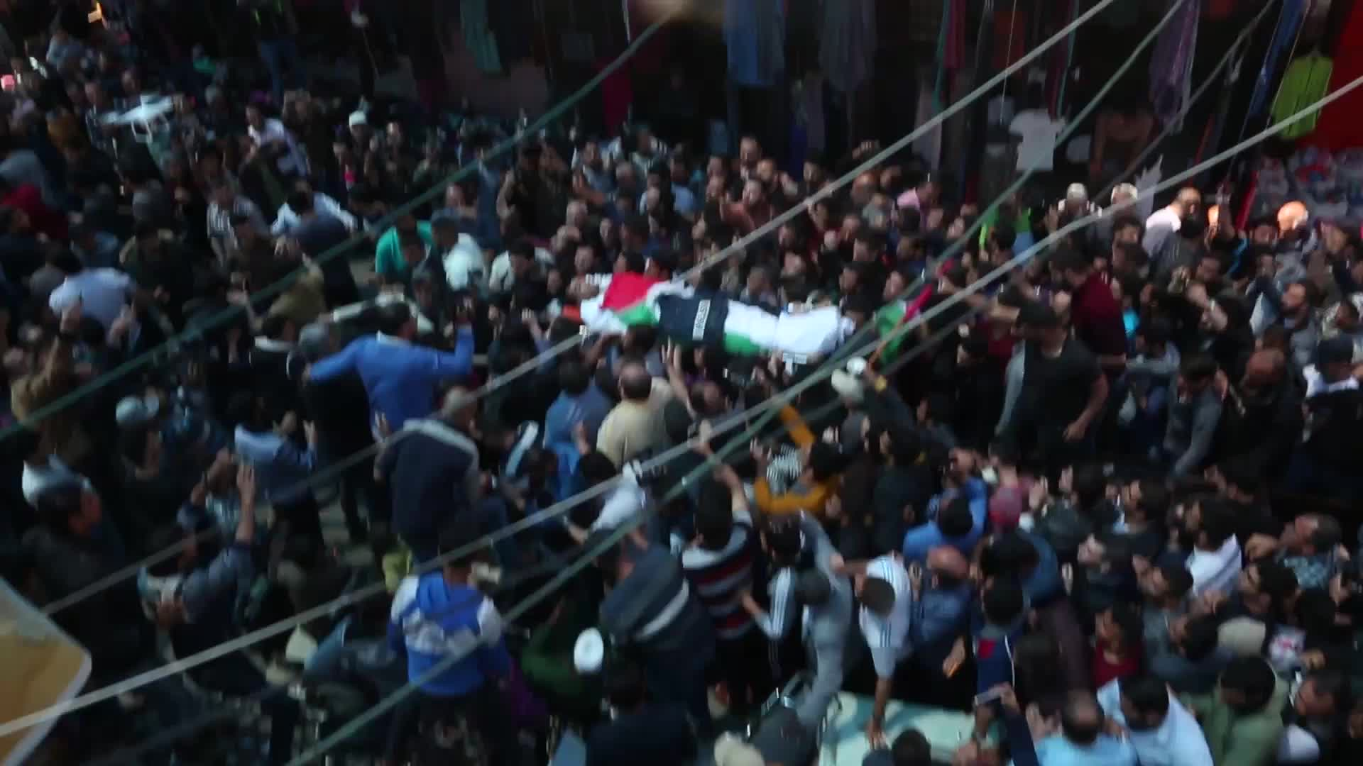 Gaza buries Palestinian journalist killed while covering mass border protest