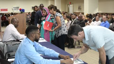 Naturalization Ceremony for New US Citizens at USCIS in Philadelphia, PA